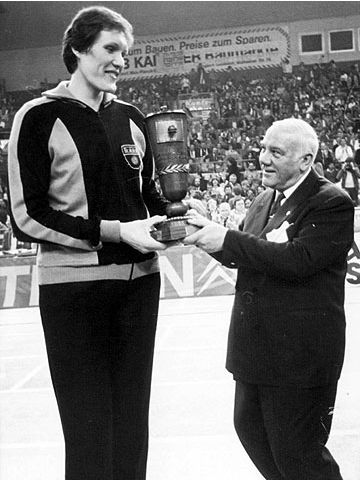 TT Riga center Uljana Semjonova is presented with the 1969 European Cup for Women's Champions clubs trophy by former FIBA President Robert Busnel. Riga defeated German side SC Chemie for the title, their 6th in a row.